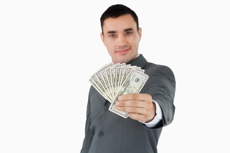 Businessman presenting bank notes against a white background photo