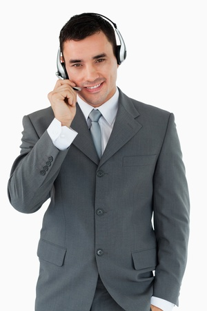 Male call center agent with headset on against a white background photo