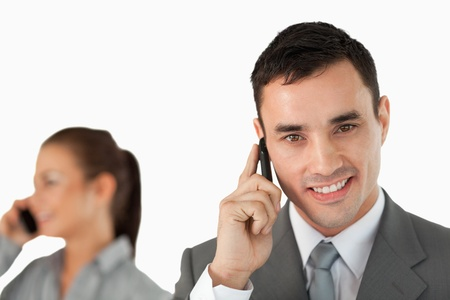 Close up of business partners on the phone against a white background photo