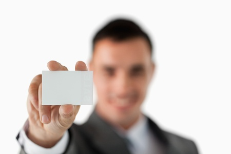 Close up of business card being shown by businessman against a white background photo