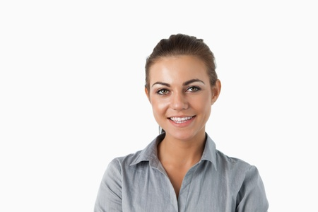 Close up of smiling young businesswoman against a white background Stock Photo - 11624074