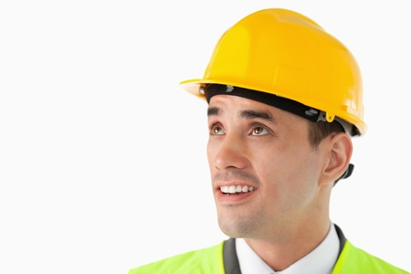 Close up of architect with helmet on looking to the side against a white background photo