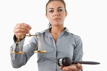 scale model: Female lawyer holding scale and gavel against a white background Stock Photo