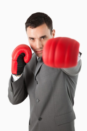Close up of boxing businessman against a white background photo
