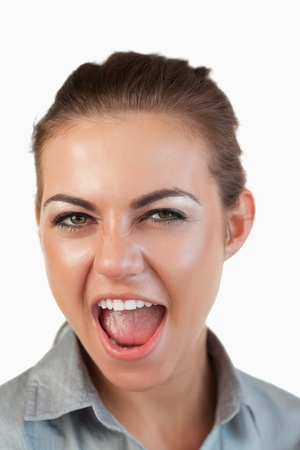 Close up of screaming businesswoman against a white background photo