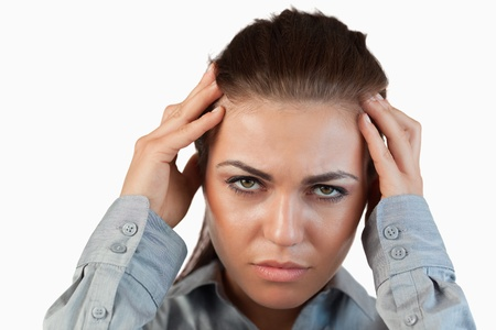 Close up of businesswoman having headache against a white background photo