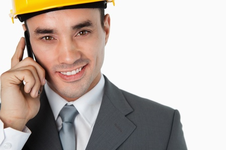 Close up of architect calling customer against a white background photo