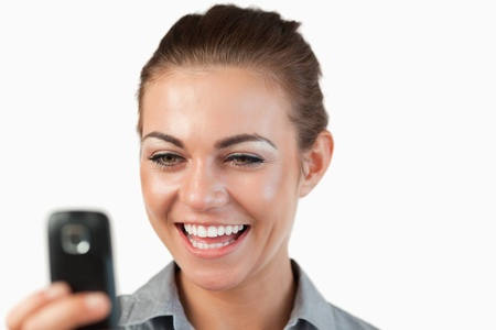 Close up of businesswoman being happy about text message against a white background Stock Photo - 11637088