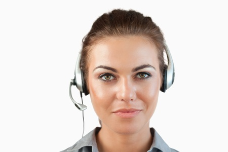 Close up of female call center agent against a white background photo