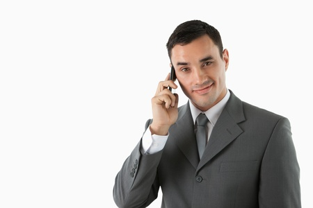 Male professional on the phone against a white background photo