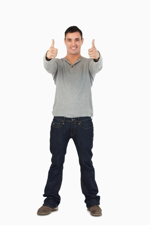 Young male giving thumbs up against a white background photo