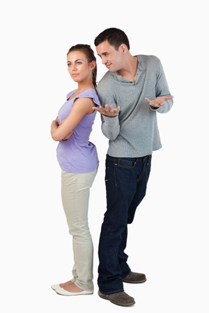 Young couple having stress against a white background photo