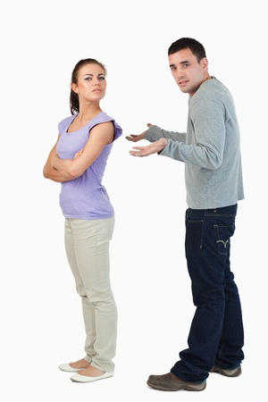 Young woman freezing off her boyfriend against a white background Stock Photo - 11637116