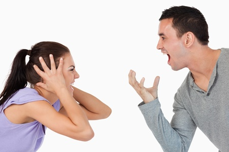people arguing: Young couple shouting at each other against a white background