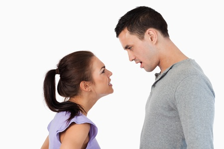 Young couple having a crisis against a white background photo