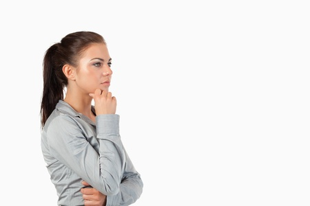 Isolated thoughtful businesswoman against a white background Stock Photo - 11623958