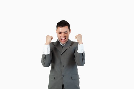 Successful businessman with the fists up against a white background photo