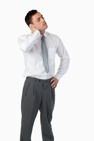 tired businessman: Portrait of a tired businessman against a white background Stock Photo