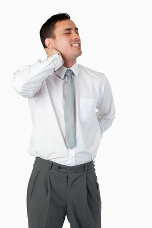 Portrait of a businessman having a back pain against a white background photo