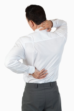Portrait of the painful back of a businessman against a white background photo