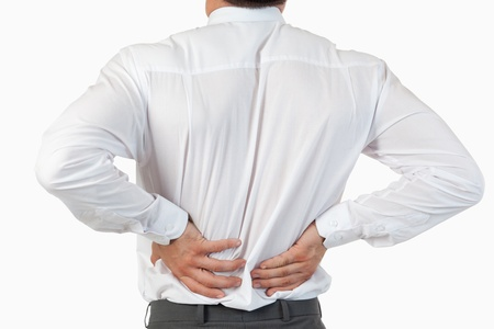 Painful back of a businessman against a white background photo