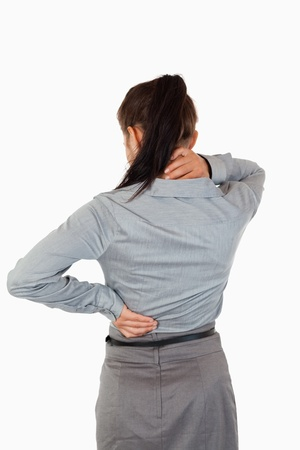 Portrait of the painful back of a businesswoman against a white background photo