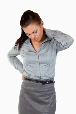 Portrait of a cute businesswoman having back pain against a white background Stock Photo - 11633285