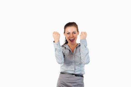 Happy businesswoman with the fists up against a white background photo