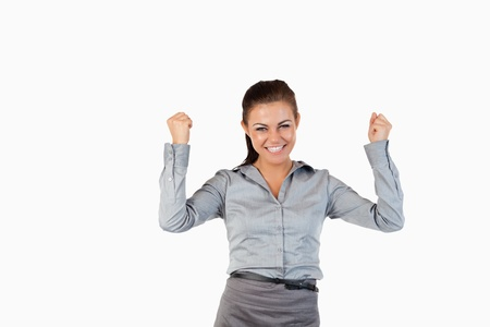 Successful businesswoman with the fists up against a white background photo
