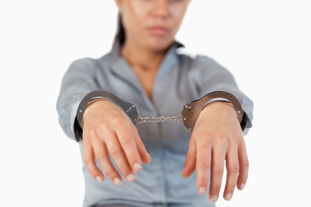 Guilty businesswoman with handcuffs with the camera focus on the hands Stock Photo - 11636615