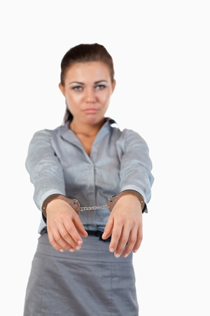 Portrait of a businesswoman with handcuffs against a white background photo