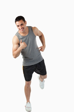 Young man warming up before workout against a white background photo