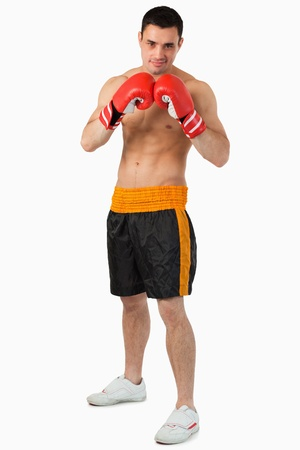 Confident looking boxer against a white background photo