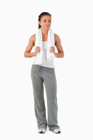 Young female with towel after workout against a white background photo