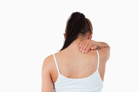 backpain: Back view of woman with pain in her neck against a white background Stock Photo