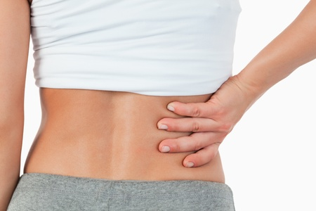 backpain: Close up of painful female back against a white background Stock Photo