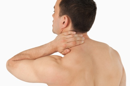 backpain: Young man experiencing neck pain against a white background Stock Photo