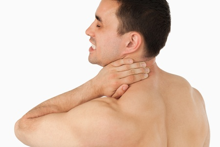 Young man suffering from neck pain photo
