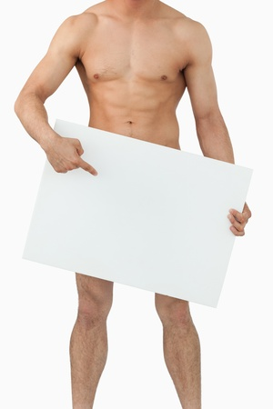 naked people: Well shaped male body pointing on banner below him against a white background
