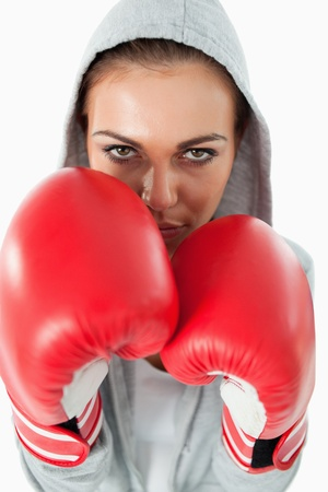 Female boxer wearing a hoodie sweater against a white background photo