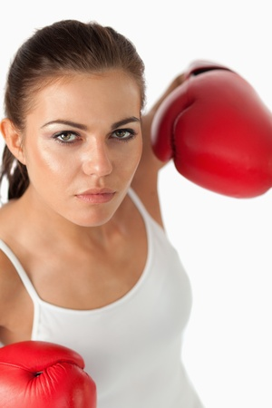 Portrait of a female boxer against a white background photo
