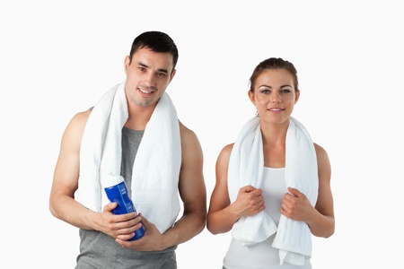 Couple going to practice sport against a white background photo