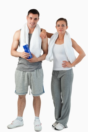 Portrait of a young couple going to practice sport against a white background photo