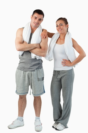 Portrait of a cute couple going to practice sport against a white background photo