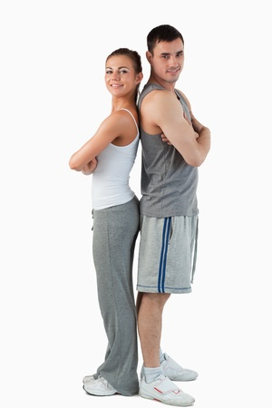 Portrait of a sports couple against a white background photo