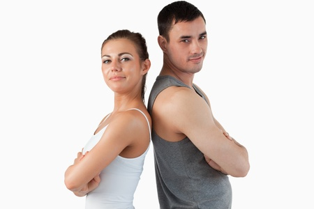 Fit couple posing against a white background photo