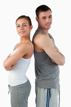 Portrait of a fit couple posing against a white background photo