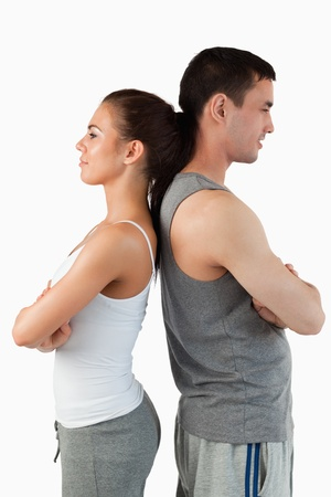 Portrait of a competitive couple against a white background photo
