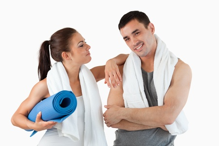 Young couple going to practice yoga against a white background photo