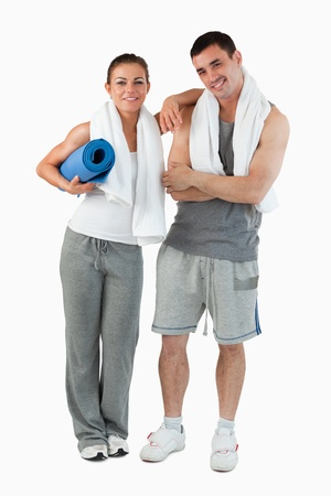 Portrait of a couple going to practice yoga against a white background photo